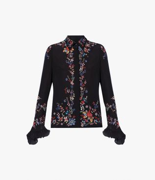 The Alaric Shirt scattered with florals and with flared, ruffle-trimmed long sleeves.