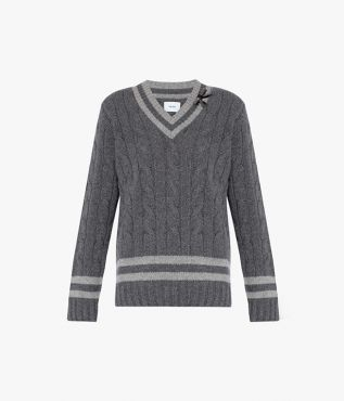 The Albertha Jumper is spun from lambswool using a chunky cable-knit technique.