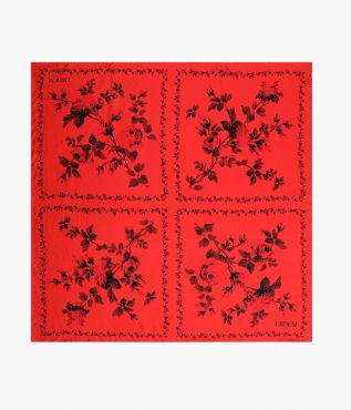 This red and black printed scarf is crafted from lightweight silk twill.