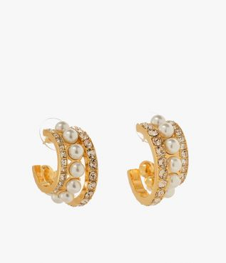 Offering a statement update on the ubiquitous hoop earring, this pair is studded with a mixture of crystals and faux pearls.