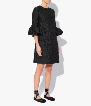 Elijah Dress crafted from textural cloqué in black that has a heavy finish that complements the structured shape.