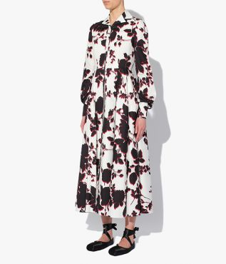 Mid-length Helaine Dress which has a lapel collar, a cinched waist and long blouson sleeves.