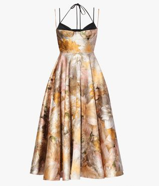 For AW21, Erdem's Rea Dress has a feminine silhouette with nipped-in waist and full, pleated skirt.