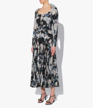 From the AW21 collection, this crepe dress is decorated with the Giselle Blossom print, a painterly floral in blue on a black.