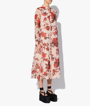 The Alyce Dress is a loose-fitting shirt style, tiered through the body and falling to a midi length.