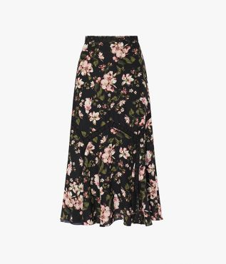 The Shea Skirt is decorated with the Margot Posy print – a delicate pink floral that sits atop a black background.