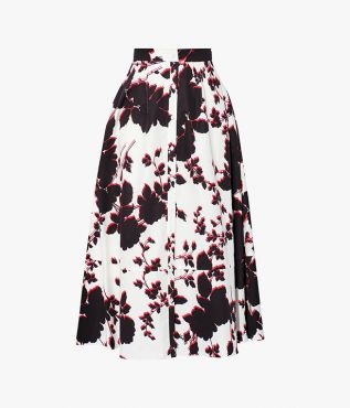 In a striking palette of white, black, and red, the Mervyn Skirt is decorated with oversized, graphic florals.