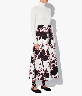 Erdem white, black, and red printed skirt from a cotton sateen that has a subtle, light-reflecting finish.