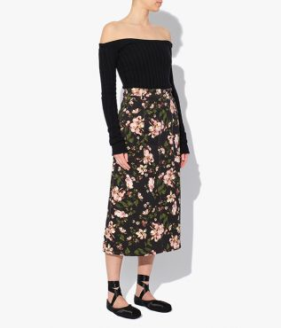 Artie Skirt in denim decorated with the Margot Posy print, a blush floral set against a black background.