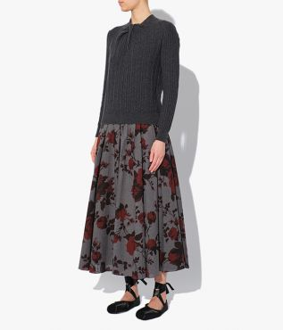 The Sadie Skirt in grey, decorated with dramatic red roses, is part of Erdem's AW21 collection.