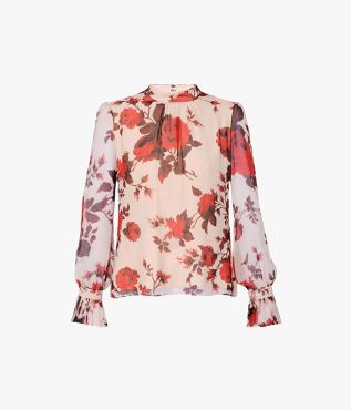 Capturing Erdem's signature romantic mood, the Barnaby Top is cut from pale pink silk voile and decorated with red roses.