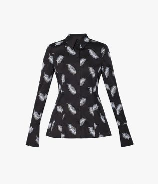 In a nod to the iconic ballet Swan Lake, the Bella Blouse in black is intricately embroidered with white feathers.