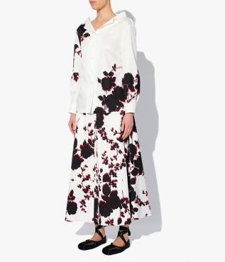 Brigit Blouse in white cotton sateen decorated with oversized black and red blooms.