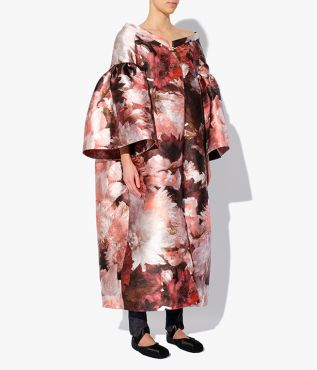 The Caitlyn Coat is an oversized design, shaped with drop shoulders, flared sleeves, and a mid-length hem.