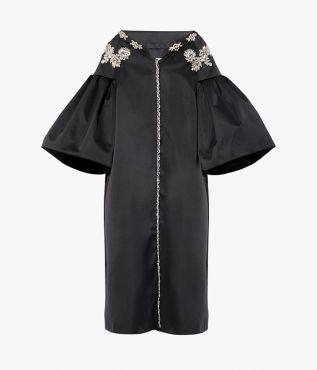 The Caitlyn Coat nods to traditional opera silhouettes with drop shoulders, flared sleeves, and a mid-length hem.