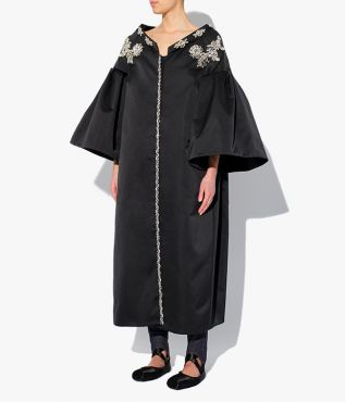 Erdem's Caitlyn Coat is a voluminous design shaped with drop shoulders, flared sleeves and an open collar shows a little skin.