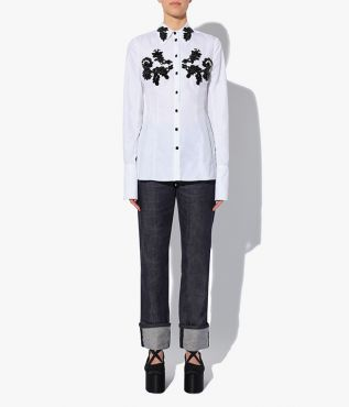 Cut from crisp cotton poplin the Bella Blouse has a pointed collar, long sleeves and a nipped waist that gently flares out at the hem.