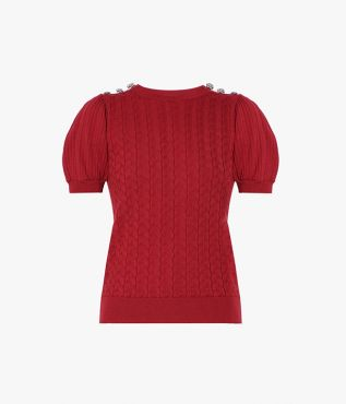 This red sweater is crafted from cotton with a touch of cashmere.