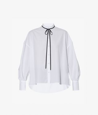 Cut from white cotton poplin, the Poet Shirt offers a romantic take on a wardrobe classic.