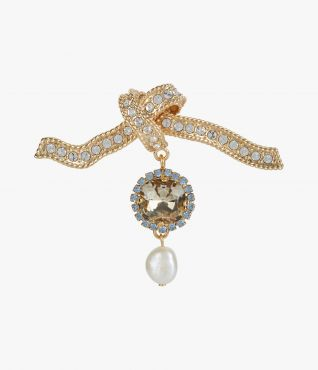 Brooch with a textural knot motif, with crystals and a dangling faux pearl.