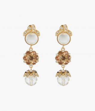 Statement earrings from Erdem which incorporate intricate crystal-embellished knotted motifs.
