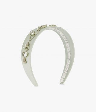 This satin headband is decorated with an array of light-catching crystals in a vine-inspired formation.