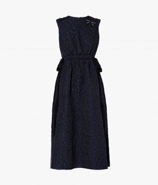 The Willene Dress is crafted from a heavyweight navy cloqué that is embossed with a unique textural pattern.