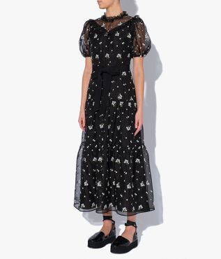 Erdem's Pearline Dress is decorated with ditsy white embroidery and a tie-fastening grosgrain bow defines the waist.