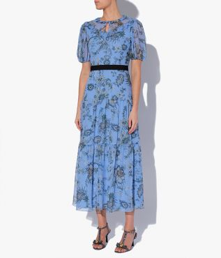 Pearline Dress with delicate ruffle trims at the collar and yoke, as well as puffed sleeves and a tiered skirt.