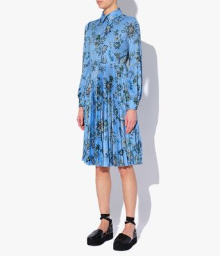 The Filomena Dress has long blouson sleeves and an intricately pleated skirt.