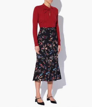 Black denim skirt printed with a multicoloured floral paisley that promises to make a statement.