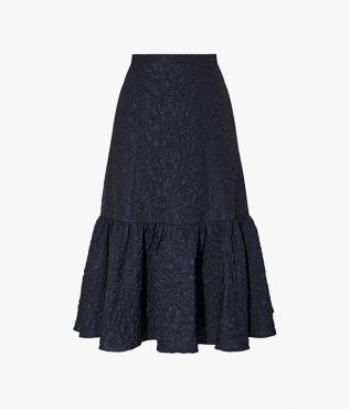 The Lue Skirt is crafted from navy textured cloqué and shaped with a dramatic tiered hem.