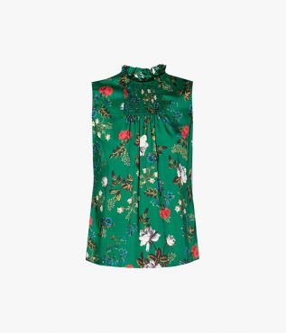 Sleeveless green top with ruffled neckline and smocked detailing.