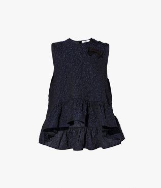 The Rutha Top is cut from navy cloqué, embossed for a uniquely textured finish.
