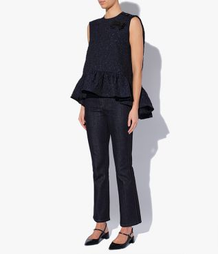 Sleeveless Rutha Top with a flounced hem that's longer at the back than it is at the front.