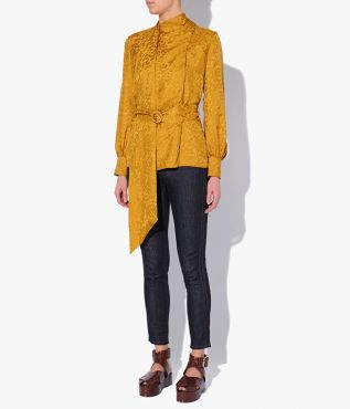 The Willia Top is crafted to include a draped, scarf-style neckline.