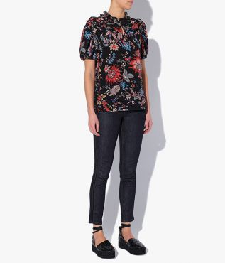 Rhea Top, cut from lightweight silk crepe de chine in a black and multicoloured floral paisley pattern.