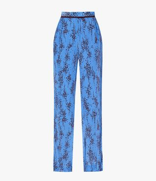 The Hortencia Trousers are made from a lightweight jacquard crepe de chine in bright blue.