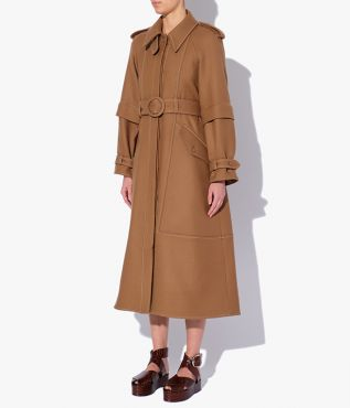 Olan Coat in camel with a pointed collar, shoulder lapels, and an array of practical pockets.