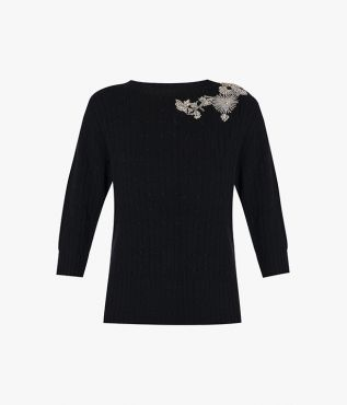 The Avice Sweater is knitted from black merino wool with a touch of cashmere.