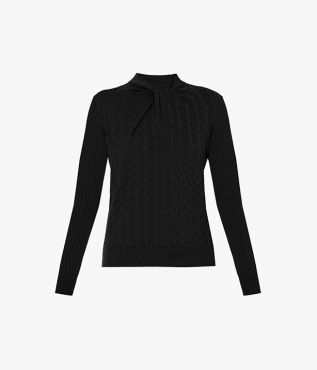 The Rae jumper combines a cable knit through the body with ribbed sleeves.