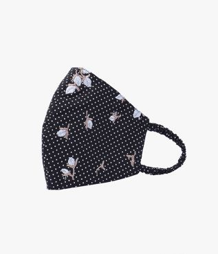 Luxury face mask from designer ERDEM, this black and white spotted cotton poplin mask is embroidered with white flower buds