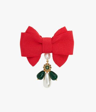 Brighten any jacket with this red grosgrain bow brooch.