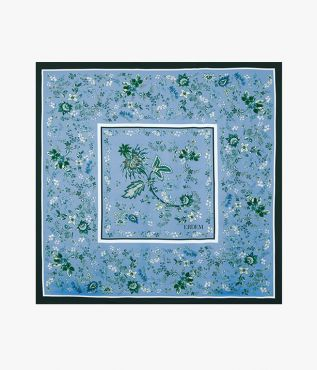 Blue scarf in a floral paisley design crafted from lightweight silk twill.