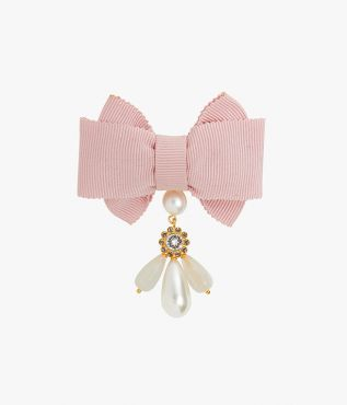 Embellished brooch crafted from pale pink grosgrain, adorned with faux pearls and glittering crystals.