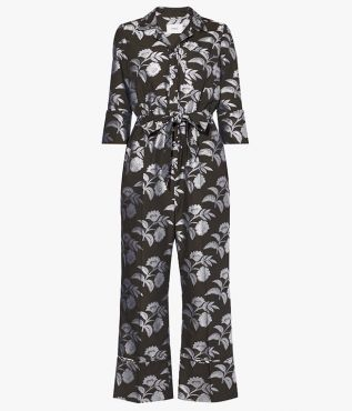The Truman Jumpsuit cut from green cotton fil coupe, detailed with contrasting white florals.
