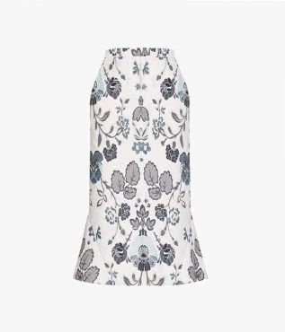 The Felton Skirt is cut from floral cotton jacquard and this white and blue design has a fresh feel to it.
