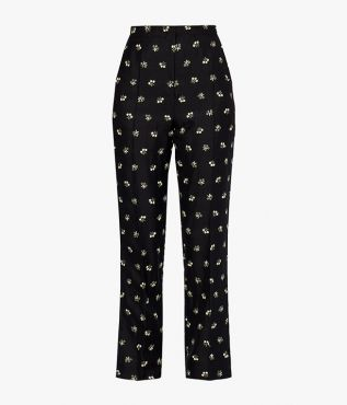 Pansy trousers embroidered with delicate white and yellow flowers.