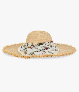 Wide-brim hat woven from raffia and adorned with a cotton bandana.
