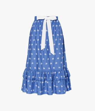 Corsica Skirt in blue cotton poplin and decorated with white ditsy embroidery.